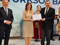 TÜRKSOY'dan AA muhabirine ödül